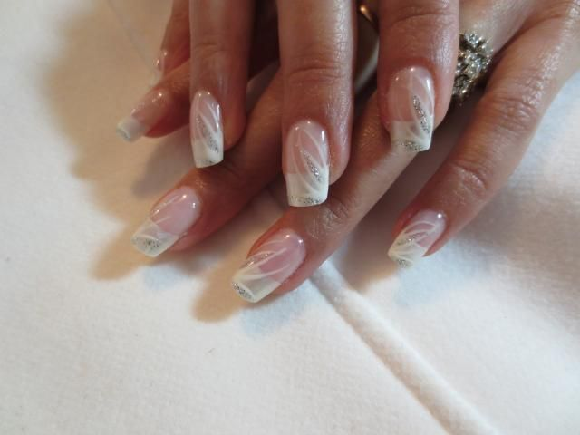 woman showing her nail art