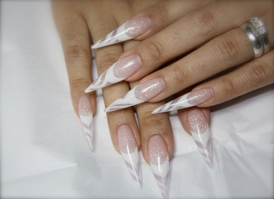 woman showing her nail extension